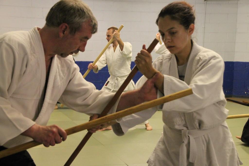 Sensei McGill guiding a student through weapons practice